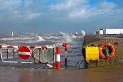 Huge waves crashing onto promenade Royalty Free Stock Photos