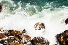Huge waves crashing on the rocks Stock Images