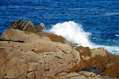 Huge waves and rocks on the seashore Stock Photography