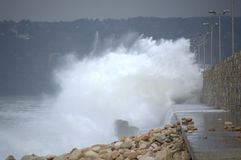 Rough sea breakwater Stock Photo