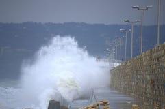 Huge waves splashes breakwater Stock Photos