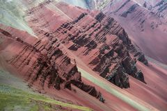 Huge weathered rocks. Huge scenic  weathered red rocks in Peruvian Andes royalty free stock image