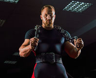 Huge weightlifter with a chain around his neck. Is in the gym Royalty Free Stock Images