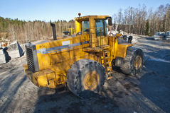 Huge wheel loader in a stone quarry. A large wheel loader that is used to lift the granite blocks. The quarry is located on Ystehede in Halden municipality Royalty Free Stock Photography