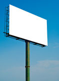 Huge white blank billboard with blue sky. Massive blank white advertising billboard with blue sky background Stock Image
