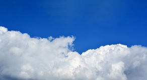 Huge white cloud on blue sky. Bright blue sky with one huge cloud. Abstract background, space for text and design. Beautiful sky Royalty Free Stock Image