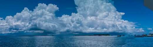 Huge White Clouds above Port in Waisai, Waigeo, Raja Ampat, West Papua, Indonesia Stock Images