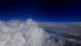 Huge white clouds and blue sky airplane stock video