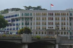Old Hill Street Police Station Singapore. Huge white colonial old hill street police station with multi coloured shuttered windows. It is a historic building in royalty free stock photography