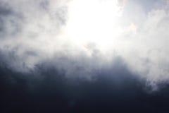 Huge white cumulus clouds against dark blue sky in spring. Stock Image