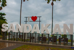 Huge white letters that says I love Sandakan and palm trees. Borneo, Sabah, Malaysia. Huge white letters that says I love Sandakan and palm trees. Sandakan city royalty free stock photos