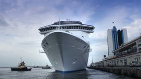 Huge white luxury cruise ship leaving port stock video footage