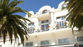 A huge white multi-storey estate in palm trees. Herceg Novi, Mon stock video footage