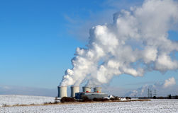 Huge white smoke from factory in winter royalty free stock photo