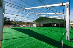 Huge white tent with green floor in field Stock Photos