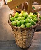 Huge wicker basket of fresh green apples stock images