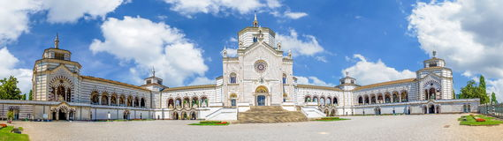 A huge wide panoram view of the entrance buildings of large monumental Cemetery in Milan, Lombardy, Italy. Bright summer Stock Image