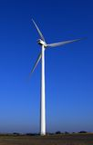 Huge wind-turbine on blue. A wind-turbine, 120m tall structure. Intensive blue sky. Vivid colours, alternative green energy royalty free stock photography