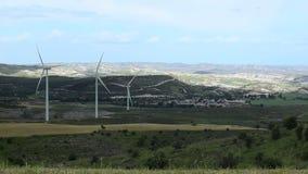 Huge wind turbine propellers rotate in green valley, generate alternative energy. Stock footage stock video