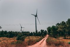 Huge windmill turbines in the Algarve region generate electricity stock photography