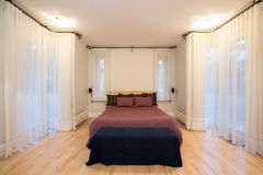Huge window in cozy bedroom Stock Image
