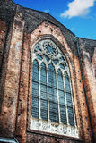 Huge window in San Petronio cathedral side wall in Bologna Royalty Free Stock Photos