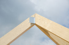 Huge wooden building joint for roof with metal. Piece Stock Photo