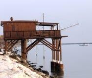Huge wooden stilt house on the seashore Royalty Free Stock Image