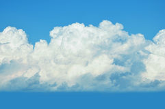 Huge wool pack clouds on a blue sky background Stock Photos