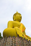 Huge yellow buddha statue Royalty Free Stock Photography