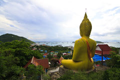 Huge yellow buddha statue Stock Photo