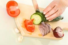 hugga av grönsaker för bräde Royaltyfria Foton