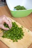 Hugga av parsley arkivbilder