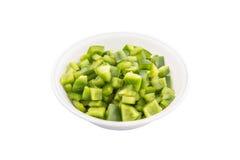 Huggen av grön spansk peppar I royaltyfri foto