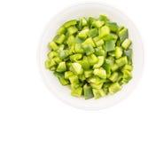 Huggen av grön spansk peppar III arkivfoton