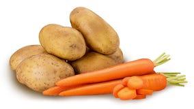Huggen av potatis- och morotcirkel royaltyfria foton
