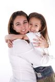 Hugging. Portrait of little girl hugging her mother royalty free stock images