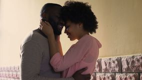 Hugging african couple enjoying city date outdoor, first love feeling, affection stock footage