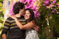 Hugging Attractive Hispanic Couple At The Park. Happy Attractive Hispanic Couple Enjoying Themselves At The Park Stock Image