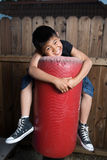 Hugging a bag Stock Photography