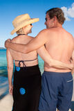 Hugging on a beach Stock Images