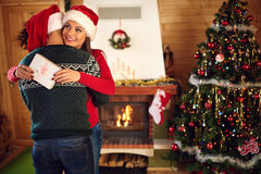 Hugging boyfriend with girlfriend for Christmas Stock Photos