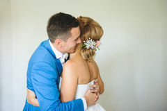 Hugging Bride and Groom. Bride and groom hugging at home Stock Photography