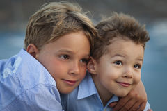 Hugging brothers. Close up of two young brothers hugging stock images