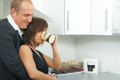 Hugging businesscouple in the kitchen Royalty Free Stock Images