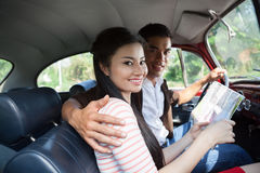 Hugging in a car Stock Photography