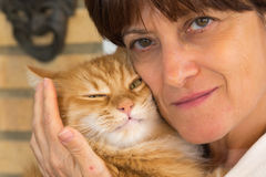 Hugging the cat Royalty Free Stock Images