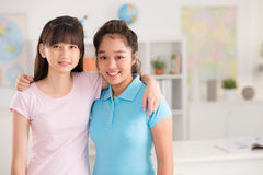 Hugging classmates Royalty Free Stock Images