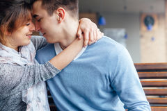 Hugging couple in cafe Stock Image
