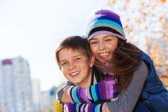 Hugging couple kids Stock Image